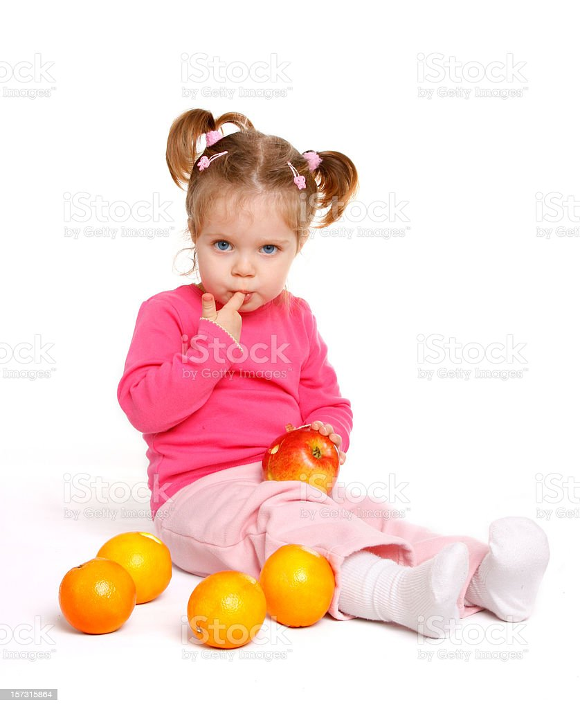 Baby girl with fruits stock photo