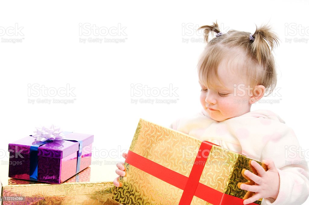 Baby girl with gifts royalty-free stock photo