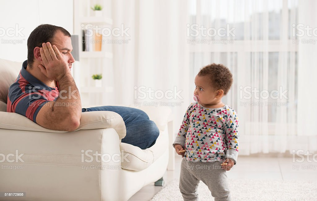 Baby girl with her father. stock photo