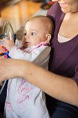 Baby girl with inhalator