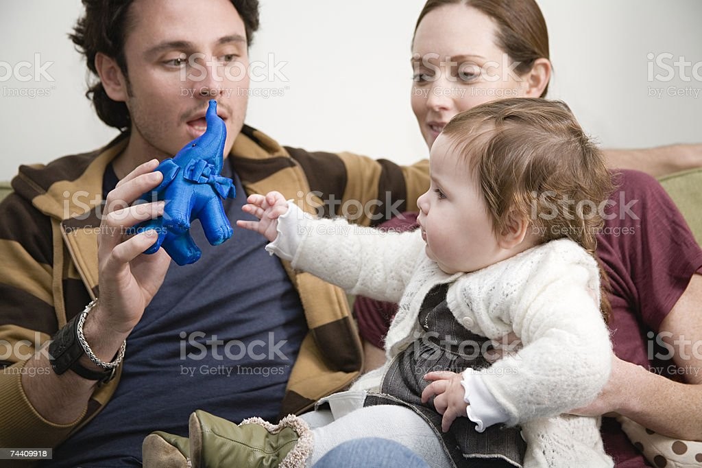 Baby girl with mother and father stock photo
