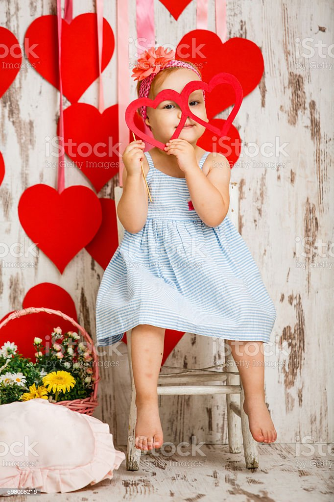 Baby girl with party glasses stock photo