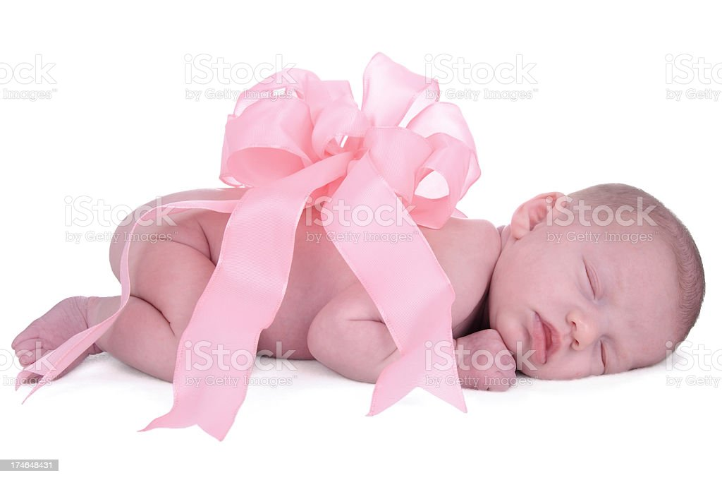 Baby girl with pink bow on her back royalty-free stock photo