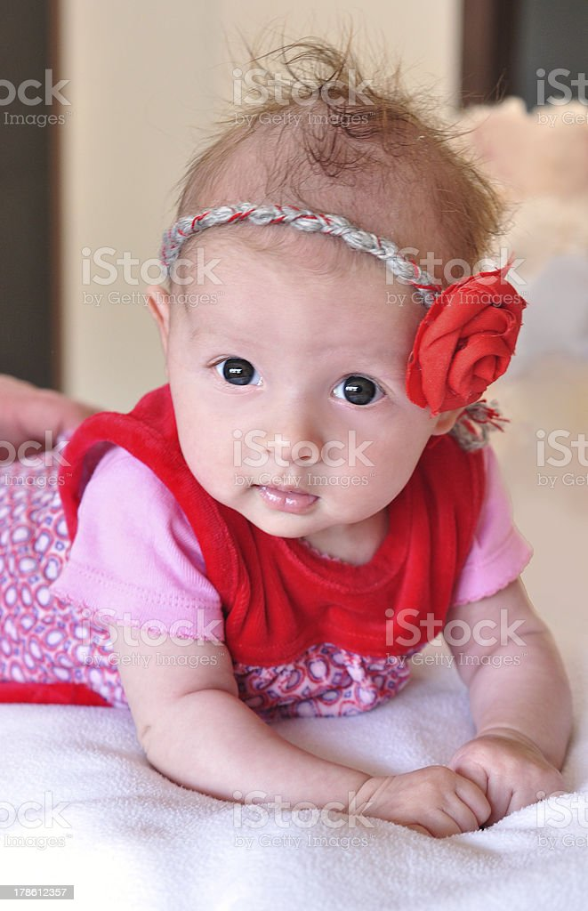 Baby Girl With Red Rose In The Hair Smiling royalty-free stock photo