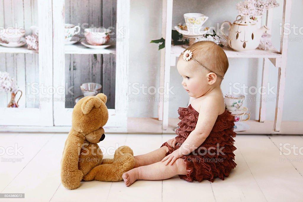 Baby Girl with Teddy Bear stock photo