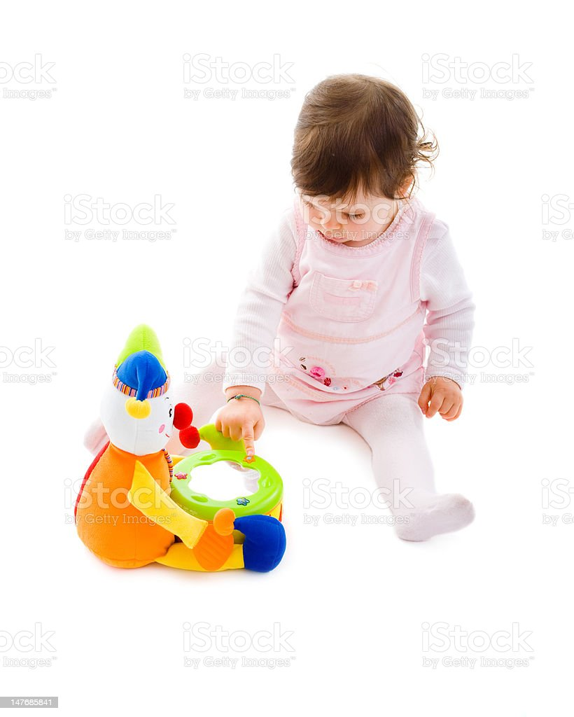 Baby girl with toy clown royalty-free stock photo
