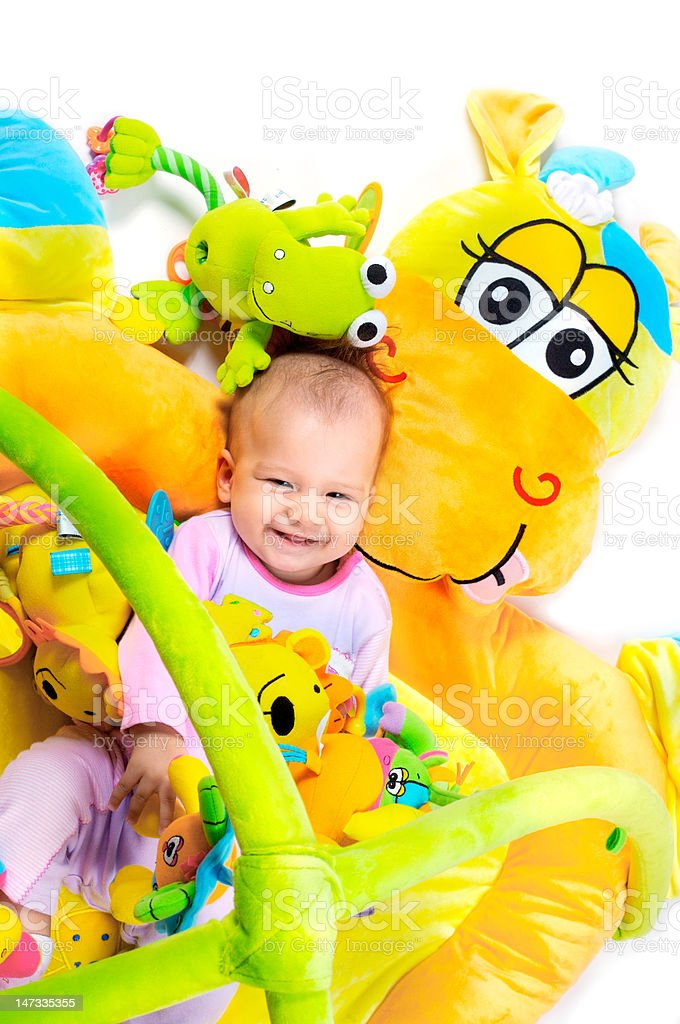 Baby girl with toys royalty-free stock photo