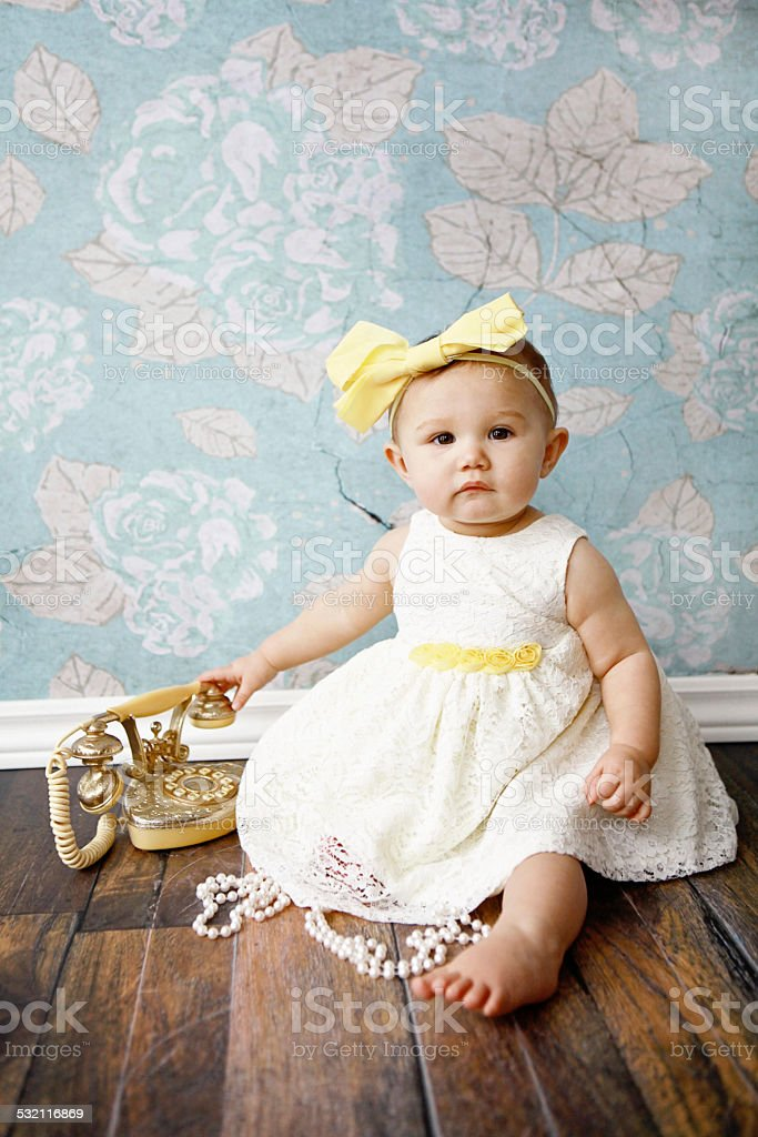 Baby Girl With Vintage Phone stock photo