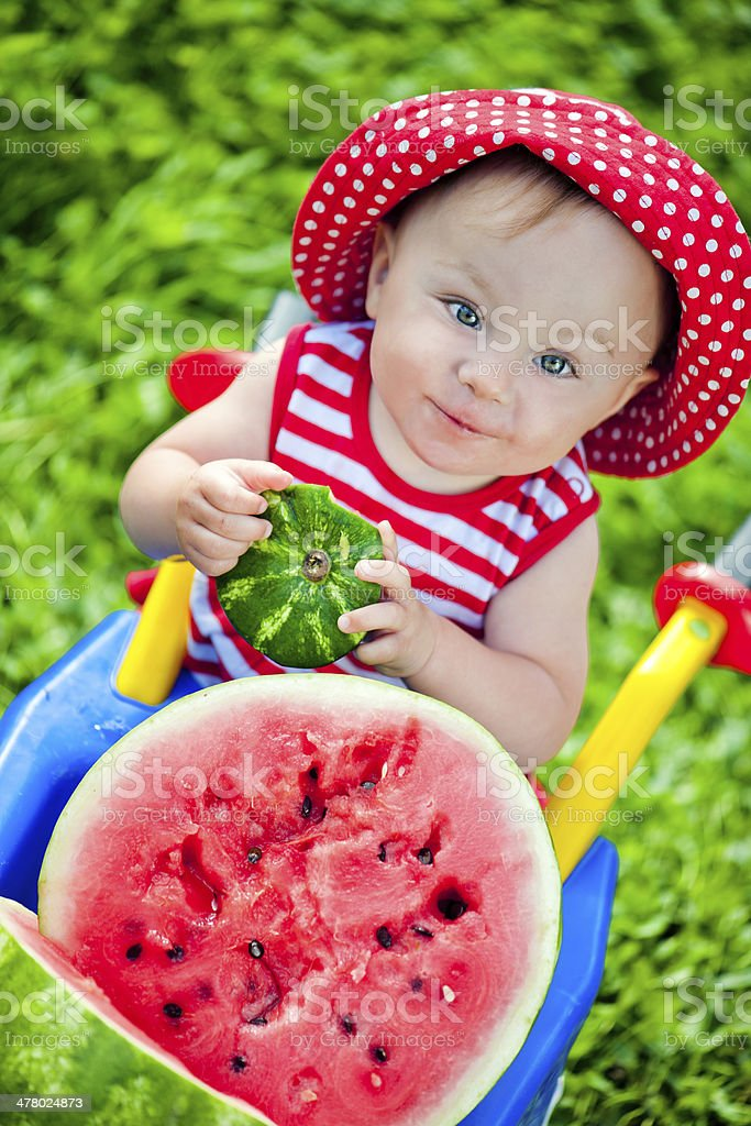 Baby girl with watermelon royalty-free stock photo