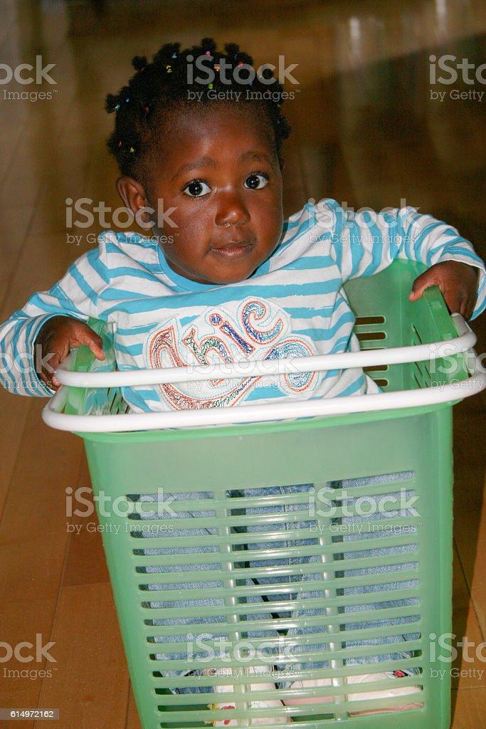 Baby Girls in Laundry Basket stock photo