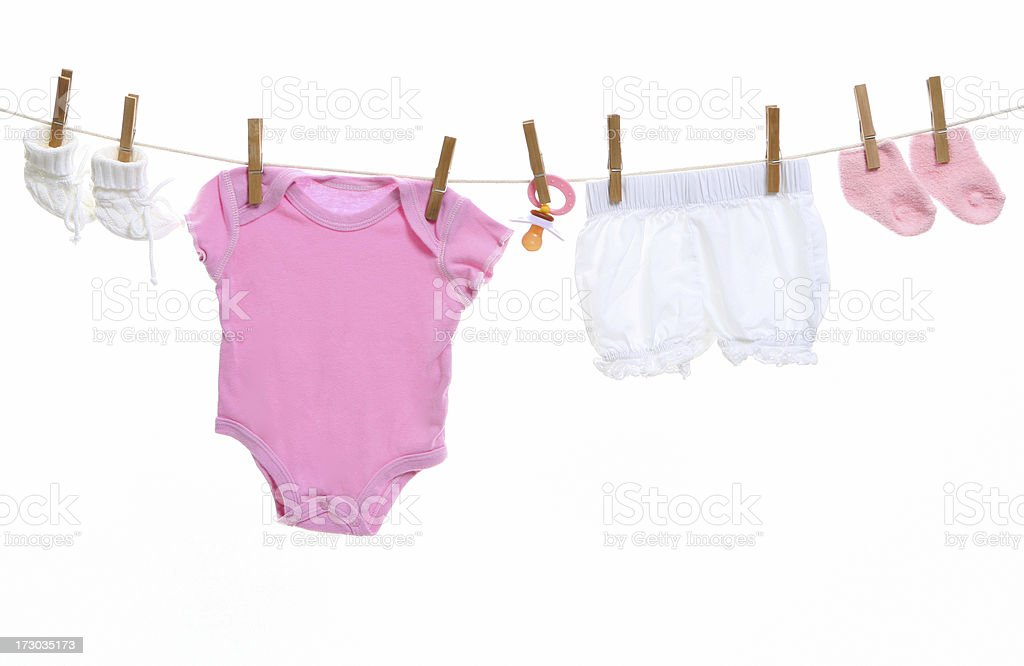 Baby goods hanging on the clothesline royalty-free stock photo