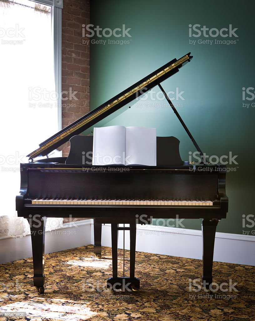 Baby Grand Piano in a Victorian Home stock photo