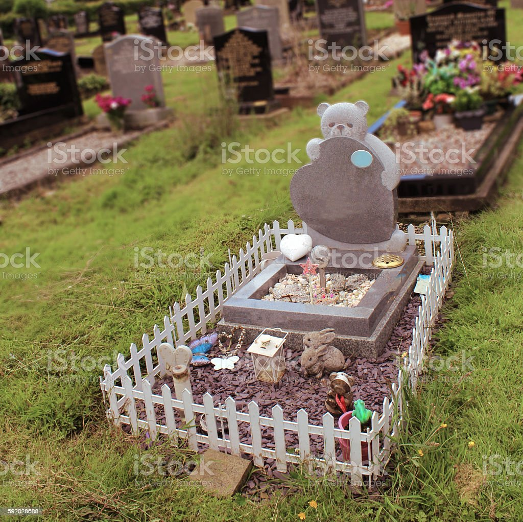 baby grave stock photo