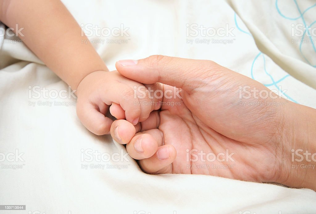 Baby hand holding mother finger royalty-free stock photo