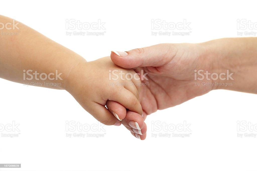 Main de bébé tenant la main mère. photo libre de droits