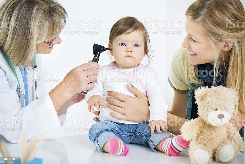 Baby Having Ear Exam at doctors office. stock photo