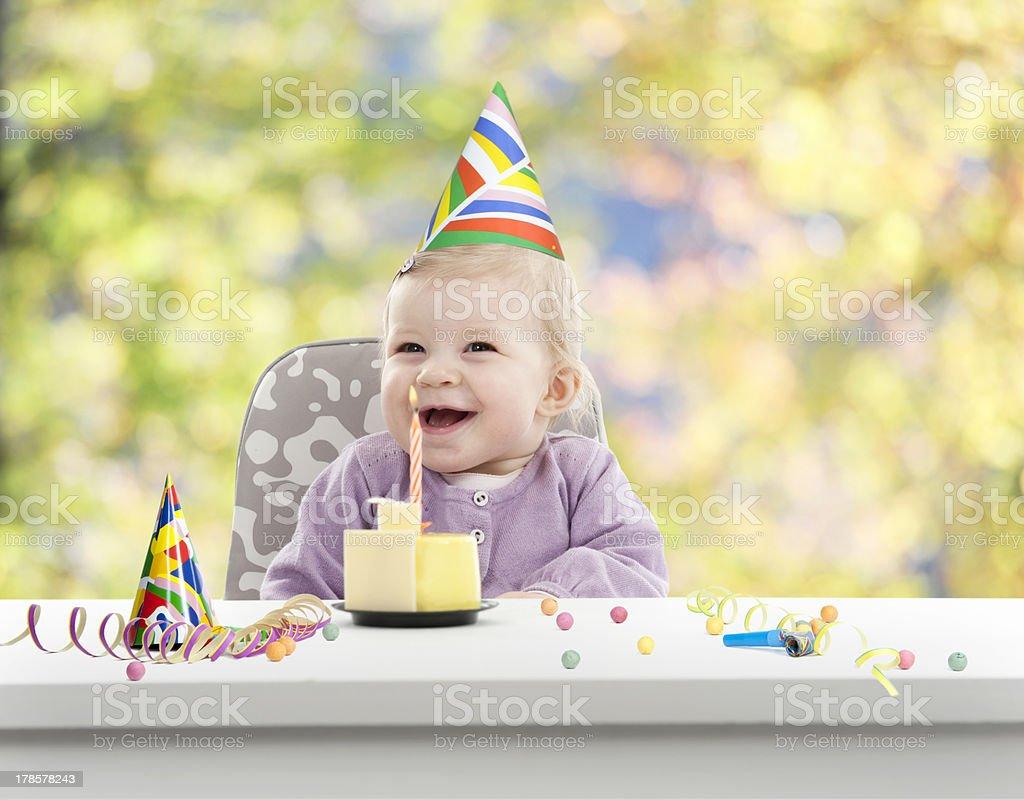baby having her first birthday,  blurred background stock photo