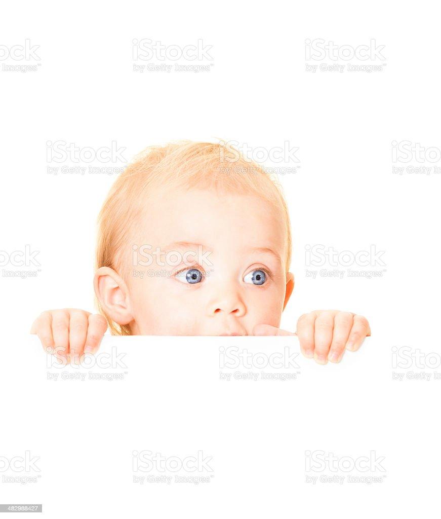 Baby Hiding Behind Billboard stock photo