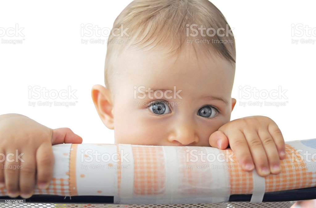 Baby hiding in playpen stock photo