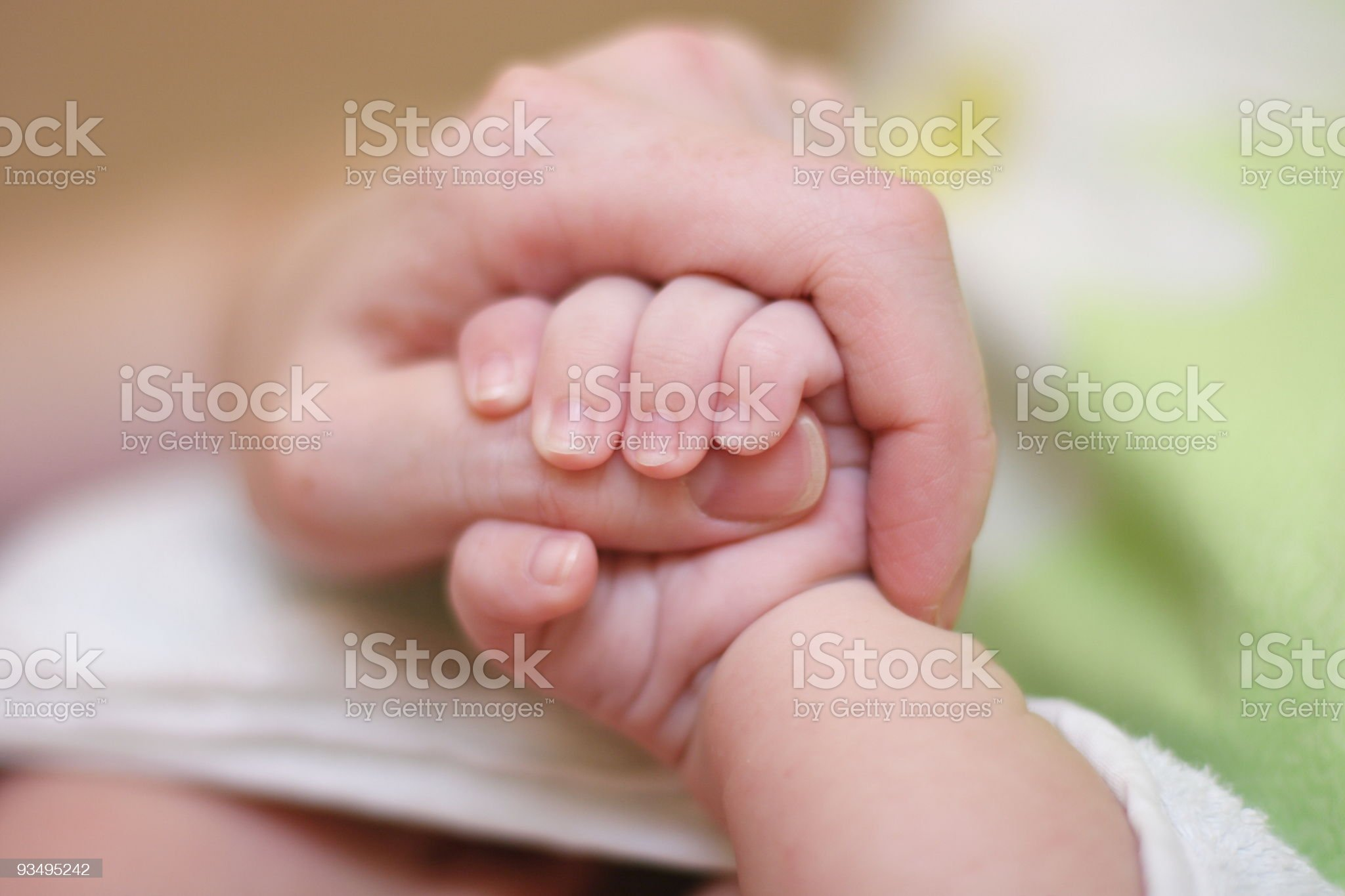 Baby hold mother finger on your hand royalty-free stock photo
