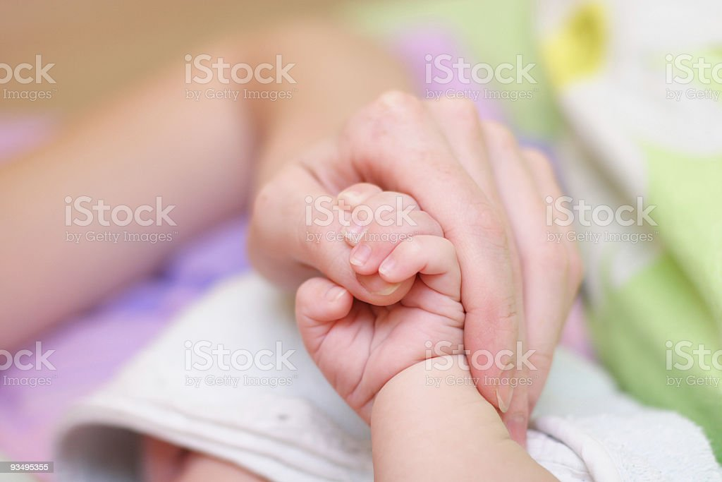 Baby hold mother finger on your hand #2 royalty-free stock photo
