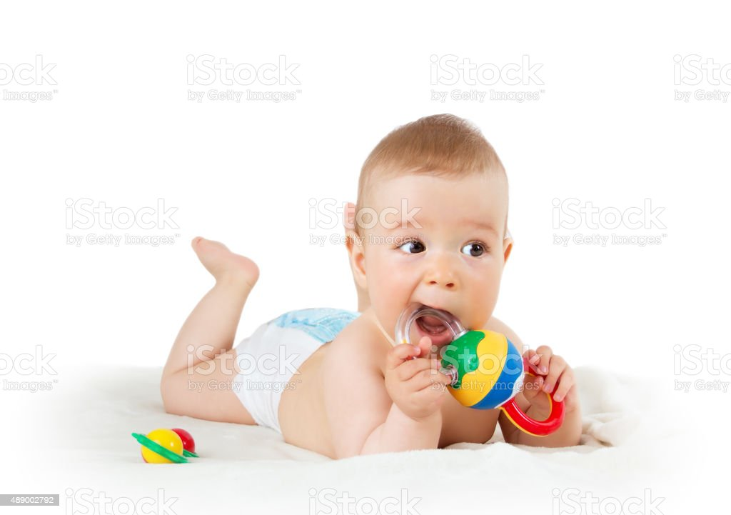 Baby holding a toy stock photo