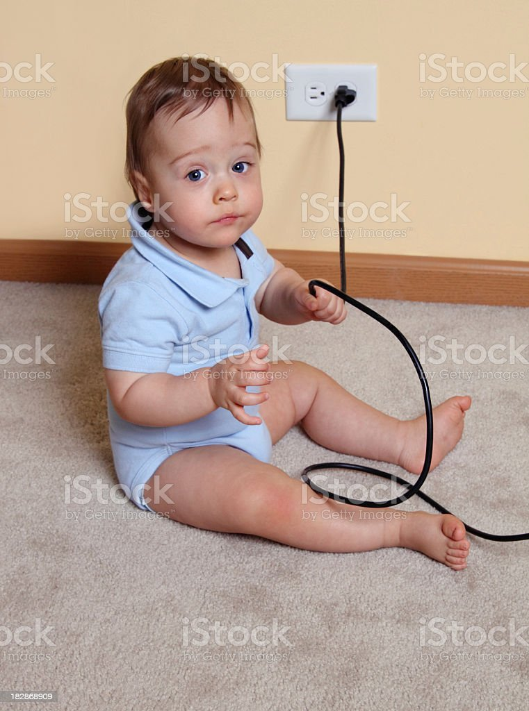 Baby Holding Electrical Cord royalty-free stock photo