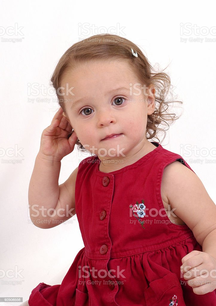 Baby holding her right ear royalty-free stock photo
