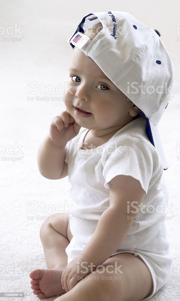 Baby in a baseball cap royalty-free stock photo