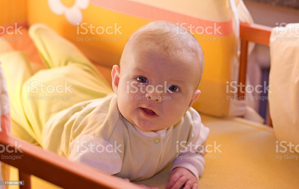baby in a cot royalty-free stock photo