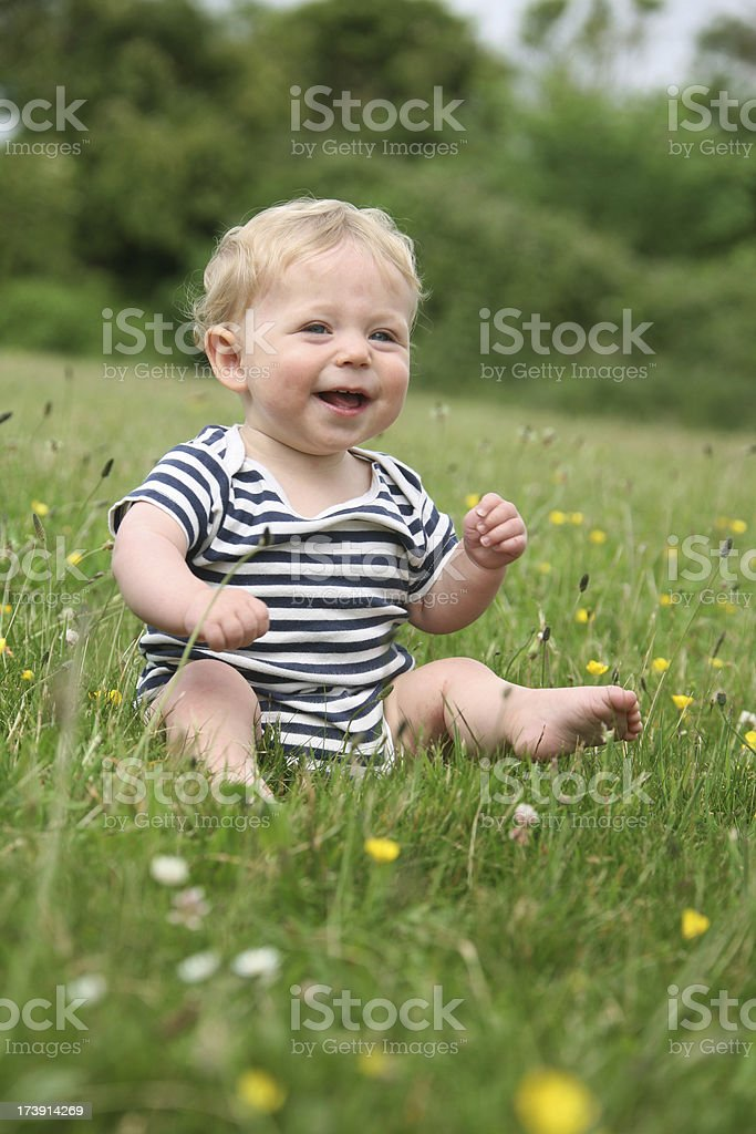 baby in a field royalty-free stock photo