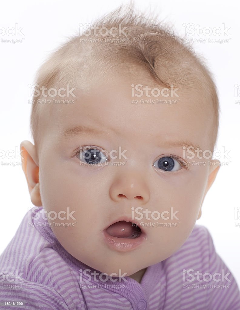 Baby in a purple jumper surprise royalty-free stock photo
