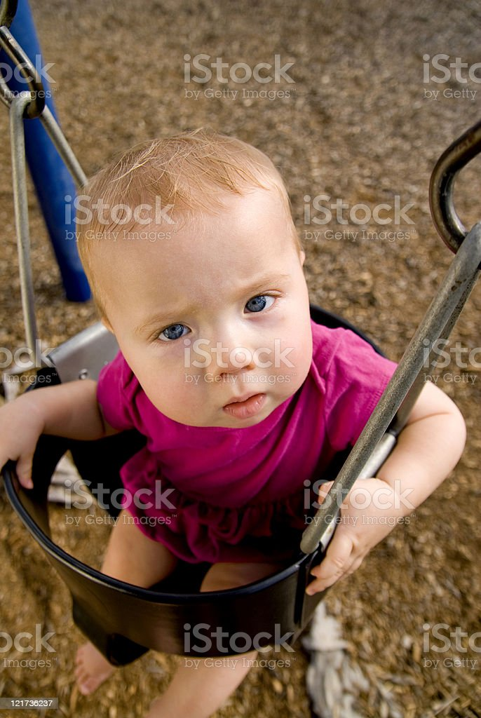 Baby in a Swing stock photo
