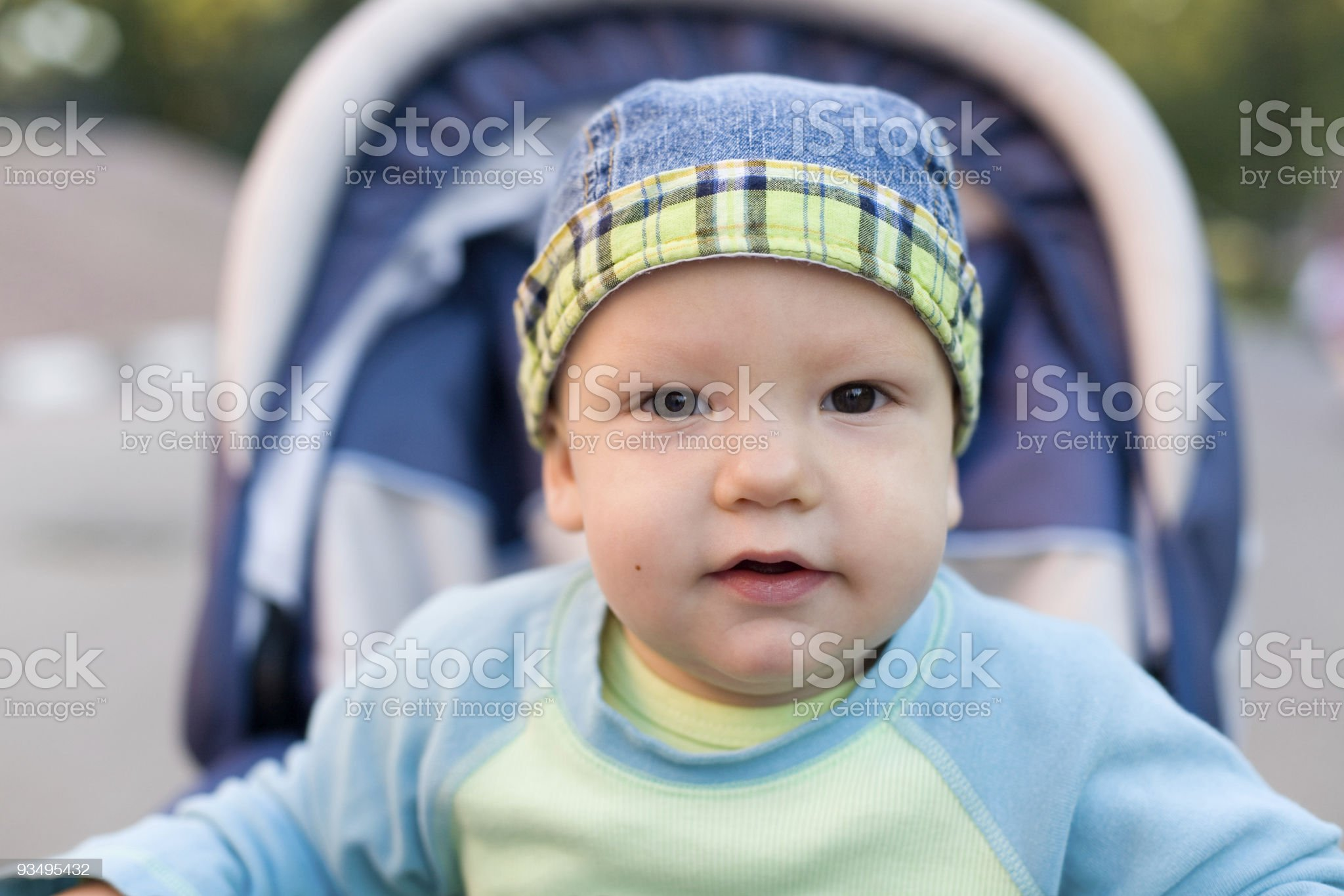 Baby in bandanna sitting stroller #13 royalty-free stock photo