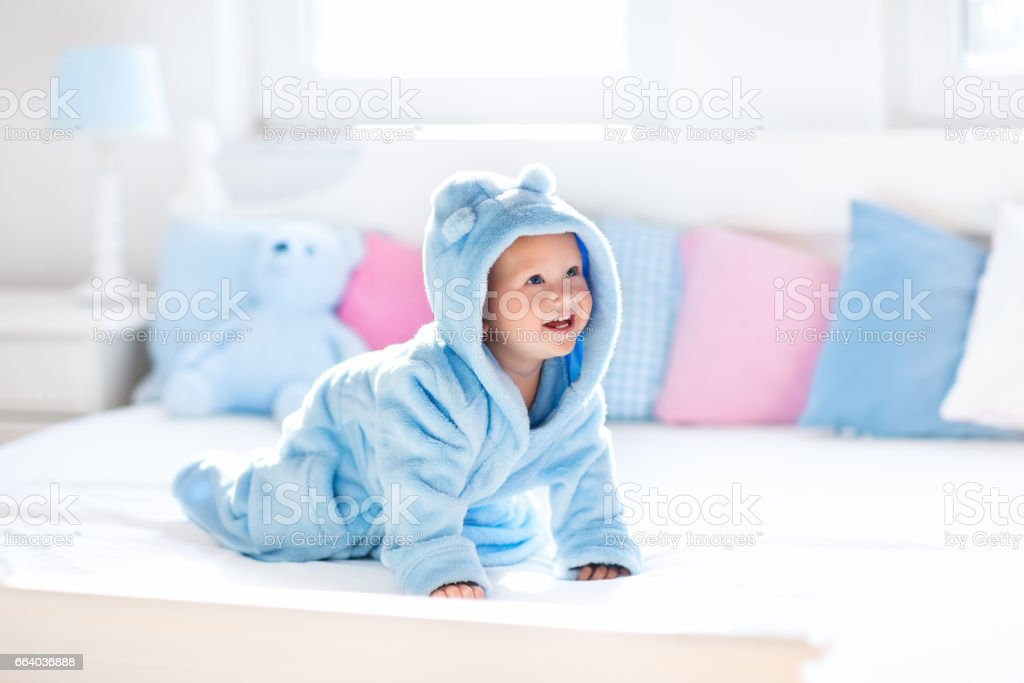 Baby in bathrobe or towel after bath stock photo