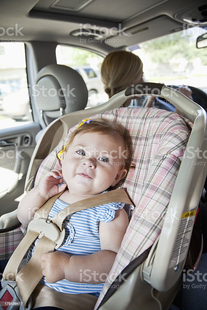 Baby in car seat, mother driving stock photo