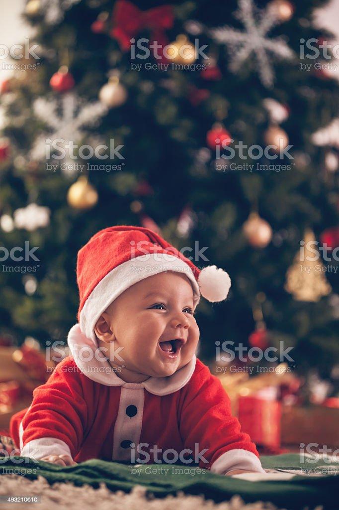 Baby in Christmas costume stock photo