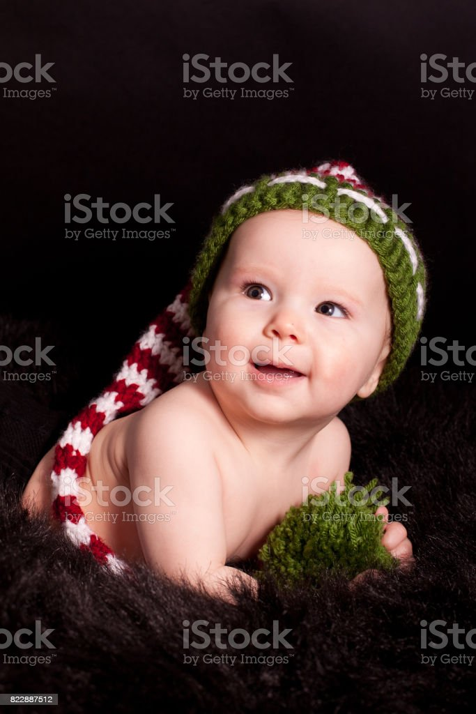 baby in funny hat stock photo