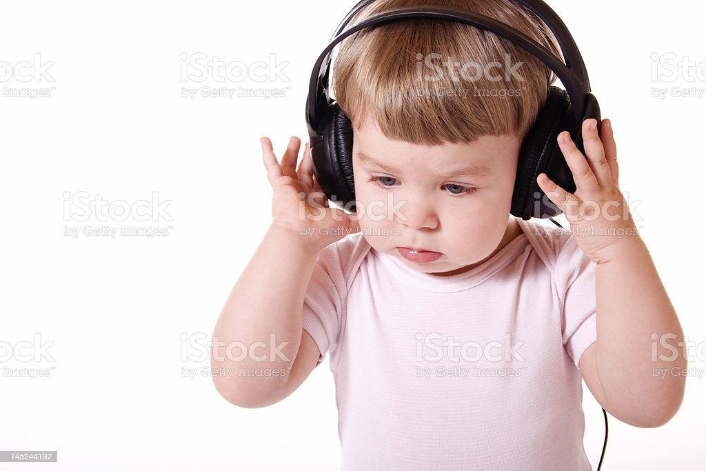 Baby in Headphones stock photo