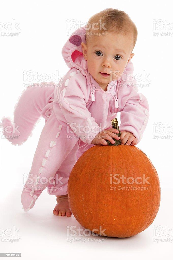 Baby in Pink Halloween Costume with Pumpkin stock photo