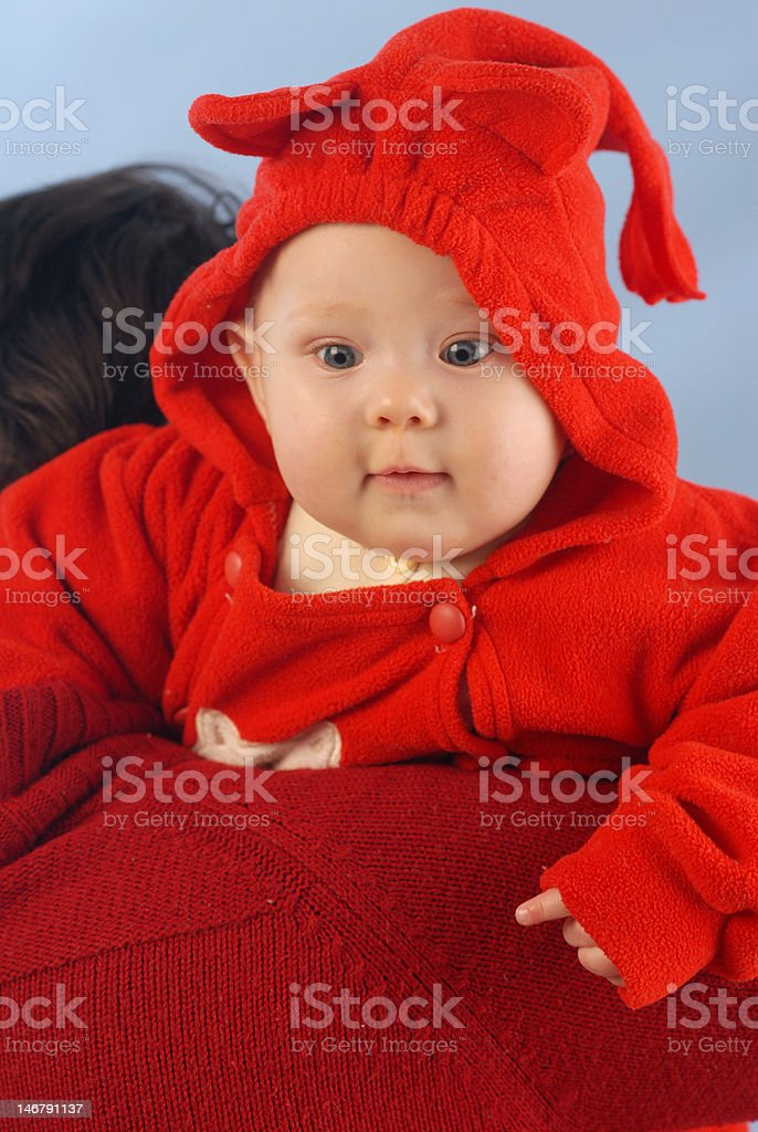 Baby in red stock photo