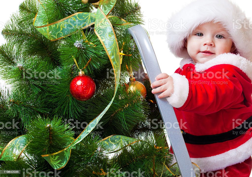 Baby in Santa costume on a step ladde royalty-free stock photo