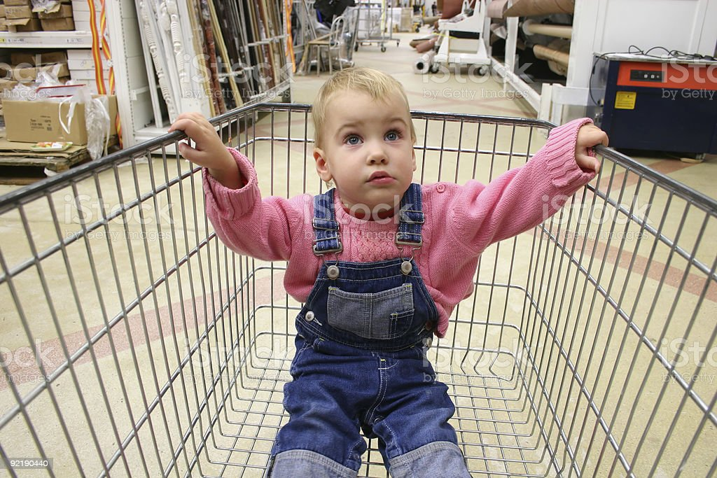 baby in shop carriage stock photo