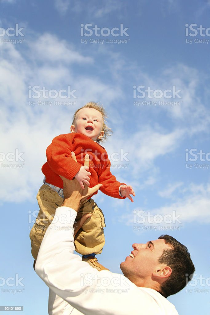 baby in sky on father's hands royalty-free stock photo