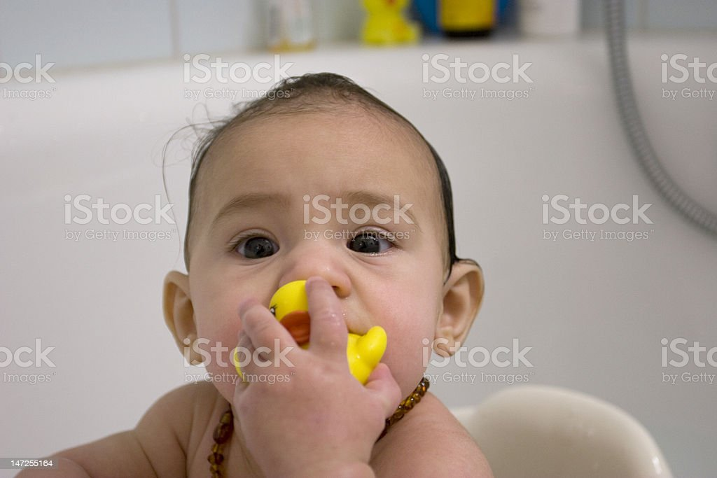 Baby in the bath with yellow duck royalty-free stock photo
