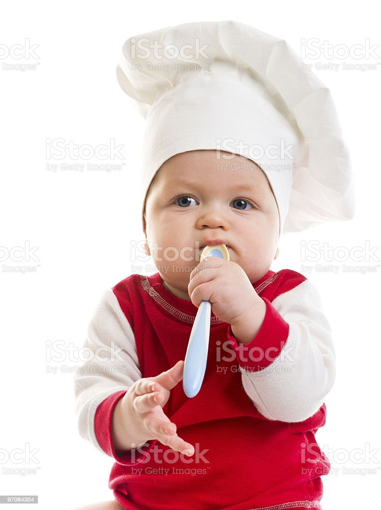 Baby in the cook hat stock photo