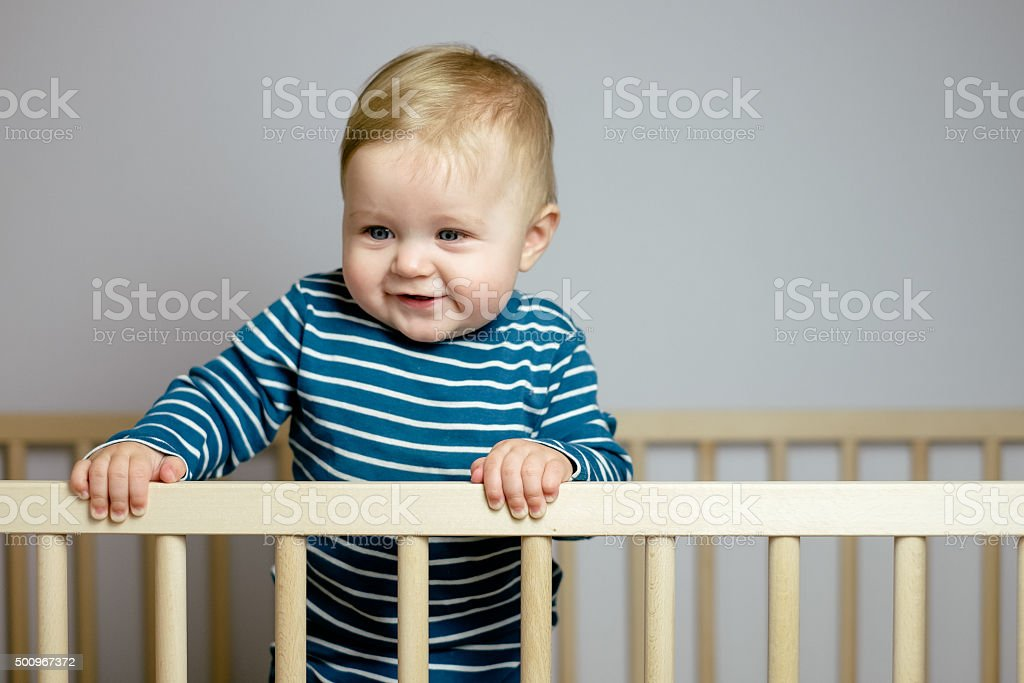 Baby in the crib stock photo