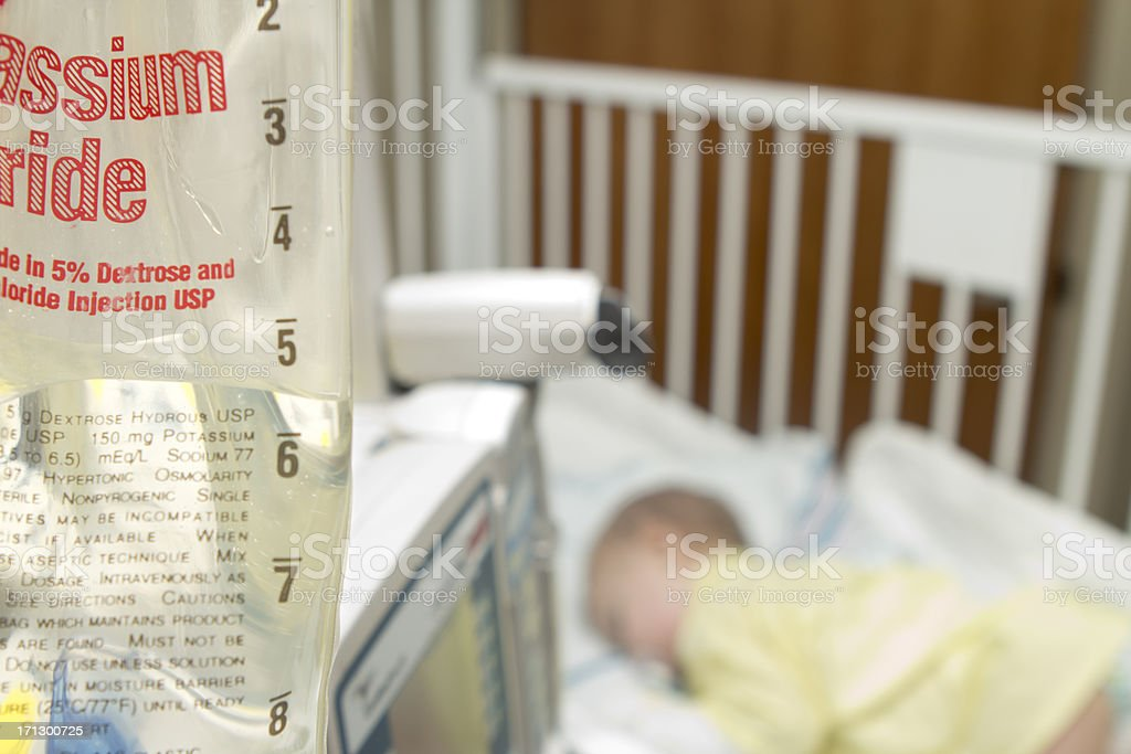 Baby in the hospital on intravenous fluids stock photo