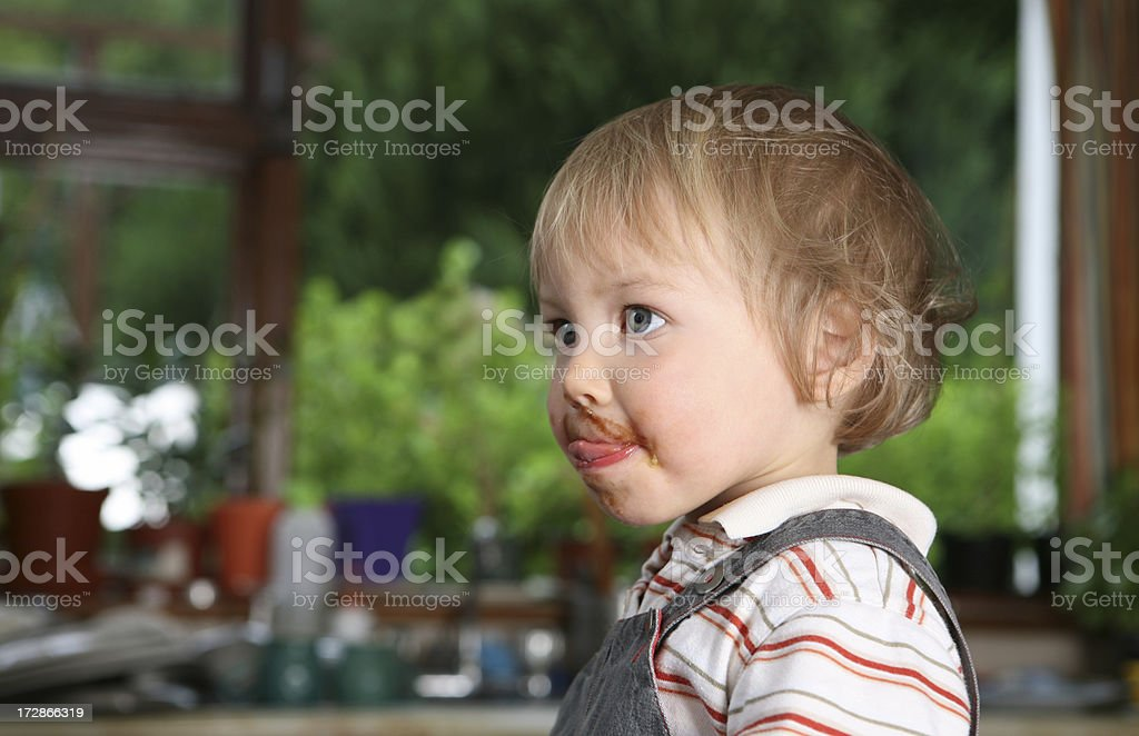 baby in the kitchen stock photo