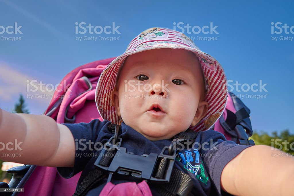 Baby in the park taking his first selfie stock photo